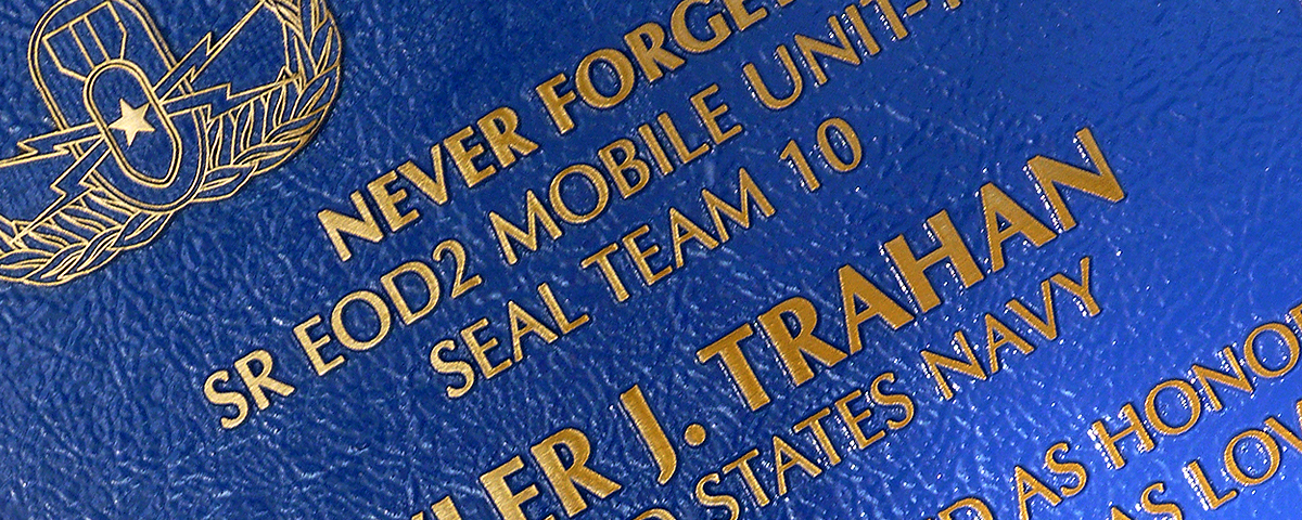 "13"" x 14"" Bronze memorial plaque with raised letters, medium blue stain & leatherette background"