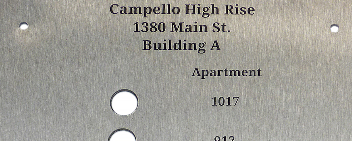 Laser engraved 9 in. x 16. stainless steel plate for apartment buzzers.