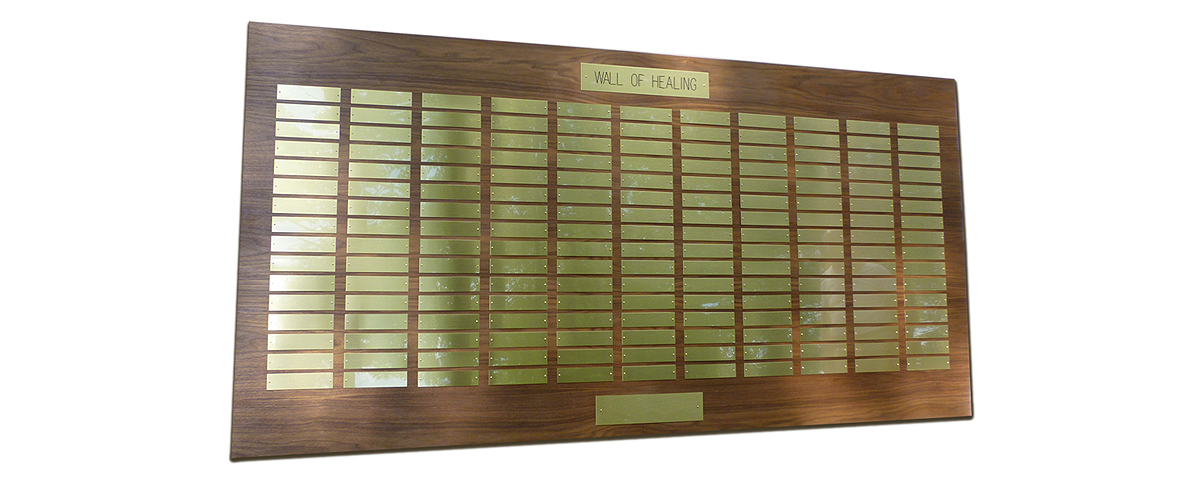7 Foot x 3 1/2 foot custom walnut perpetual plaque with 176 brass plates. Board finished by MJF Woodworking