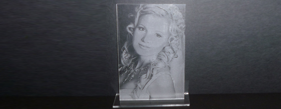 Photo engraving on clear acrylic and displayed with a black backdrop.