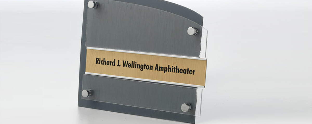 Double panel standoff sign with silver metal name plate holder.